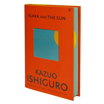 Picture of the cover of Kazuo Ishiguro's Klara and the Sun, on a red cover, a window of blue shows a sliver of the sun which is echoed in the sprayed edges of the pages to give the impression of the sun setting around the book.